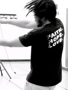"Christian artist, LJ, dancing to hip hop. The back of his shirt says ""Faith. Hope. Love."""
