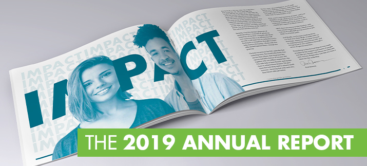 "The 2019 Annual Report, laid out to a spread of two pages where you see two smiling faces and the word ""IMPACT""."